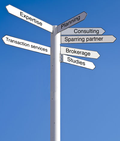 Sign labeled with Expertise, Planning, Consulting, Sparring partner, Brokerage, Studies and Transaction services